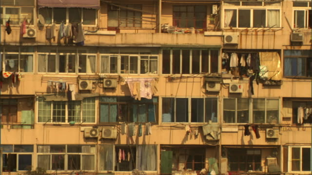 medium static - laundry hangs from apartment balcony railings in shanghai. / shanghai, china - klimaanlage stock-videos und b-roll-filmmaterial