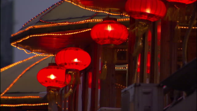 medium static , red paper lanterns sway in a breeze. / china - tassel stock videos & royalty-free footage