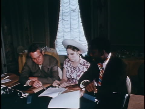 medium three shot newman streisand poitier seated at desk signing document for new production company - barbra streisand stock videos & royalty-free footage