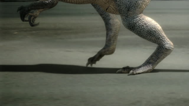 Medium tilt-up tracking-left zoom-in zoom-out - A dramatization shows a bipedal dinosaur hunting. / Dallas, Texas, USA