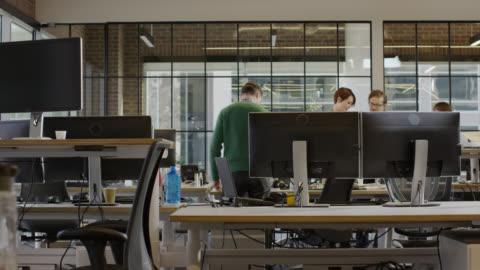 medium time lapse panning shot of business people working in office / lehi, utah, united states - planering bildbanksvideor och videomaterial från bakom kulisserna