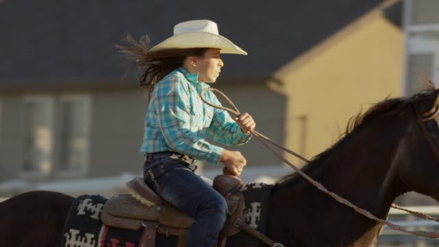 medium tracking shot of girl riding horse / lehi, utah, united states - lehi stock videos & royalty-free footage