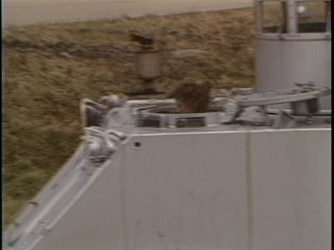 "medium tracking shot off sticks of a large silver tank with the number ""2"" painted on it. it is driving around in a field, and christa mcauliffe's... - spielkandidat stock-videos und b-roll-filmmaterial"