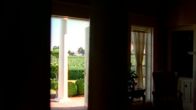 medium tracking shot portrait of thomas jefferson in building at jefferson vineyards/ through room and out door to brick walkway/ charlotteville, virginia - thomas jefferson stock videos & royalty-free footage