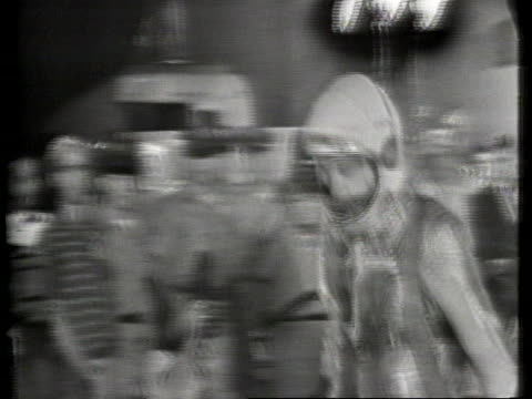 medium tracking shot that begins fixed on a doorway. an older man dressed in normal clothing walks through it, and he is followed by alan shepard,... - alan b. shepard jr stock videos & royalty-free footage