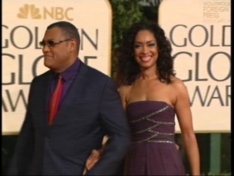 medium two shot fishburne and torres posing - the beverly hilton hotel stock videos & royalty-free footage