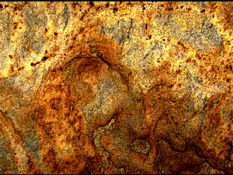 medium wide pan right of a brown toned granite stone. - igneous stock videos & royalty-free footage