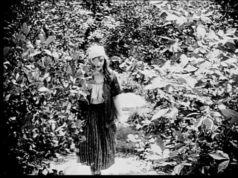 1916 b/w mediums shot peasant woman walking down forest path and looking around - 1916 stock videos & royalty-free footage