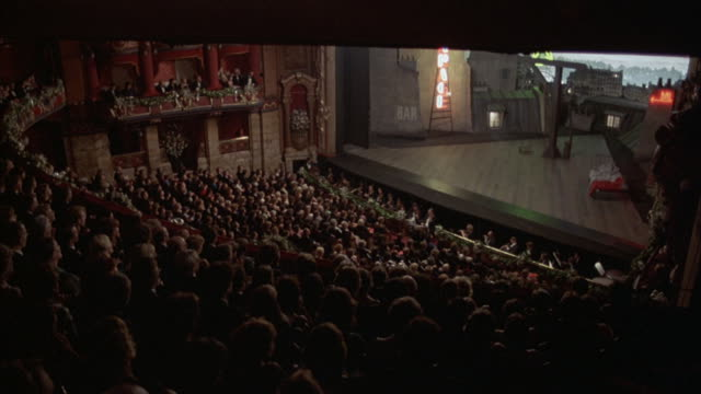 Medium-shot an audience clapping when the curtain falls at the Kirov Theater in St. Petersburg, Russia.