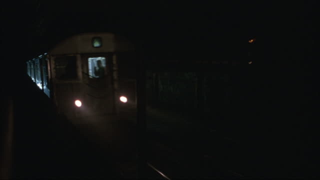Medium-shot of a passing subway train.