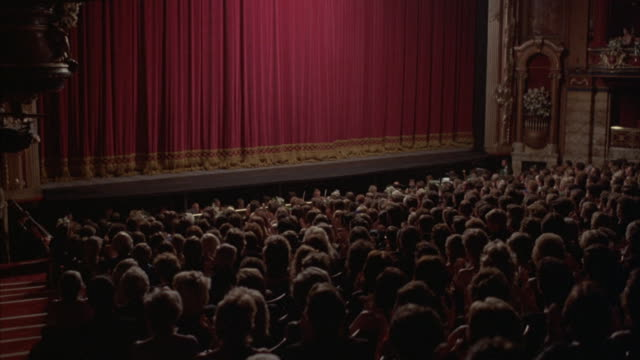 medium-shot of an audience clapping when the curtain falls at the kirov theater in st. petersburg, russia. - formal stock videos and b-roll footage