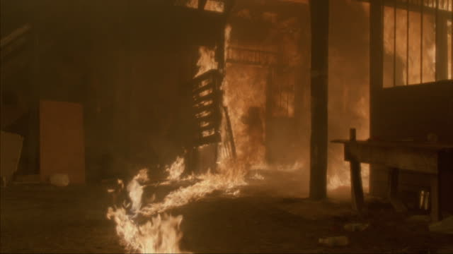 Medium-shot of interior of burning building.