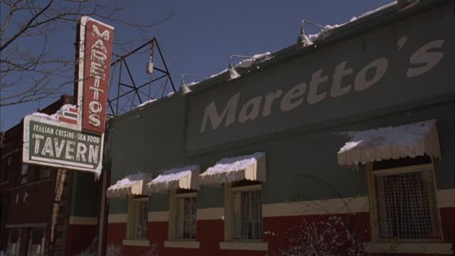 Medium-shot of Maretto's Restaurant advertising Italian cuisine and seafood.