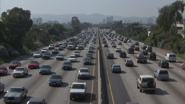 medium-shot of traffic on a ten-lane los angeles freeway. - traffic jam stock videos & royalty-free footage
