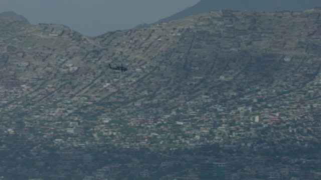 stockvideo's en b-roll-footage met medi-vac flying over kabul city - afghanistan