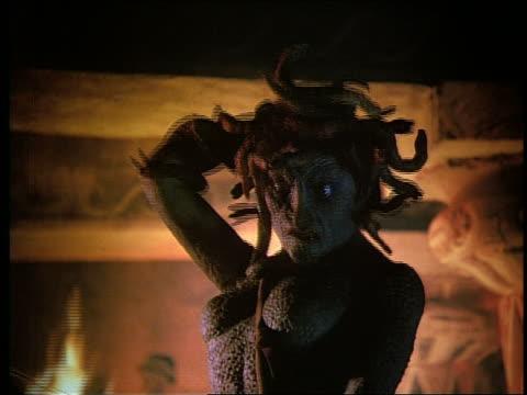 Medusa raising her hand