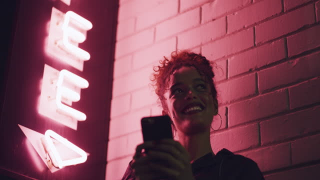 meet me next to the neon sign - neon coloured stock videos & royalty-free footage