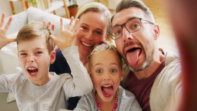 meet my crazy family - pulling funny faces stock videos & royalty-free footage