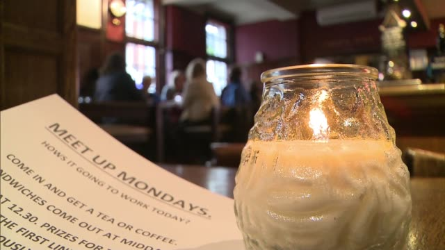 'Meet Up Mondays' campaign by pub in Wimbledon hopes to tackle loneliness ENGLAND London Wimbledon The Alexandra INT Man and woman hugging inside pub...