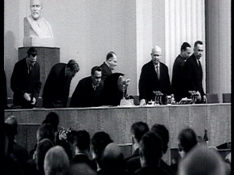 vídeos de stock e filmes b-roll de meeting at the kremlin intellectuals with khrushchev representatives of soviet literature and arts audience stands and applauds the arrival of... - leonid brezhnev