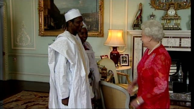vídeos de stock, filmes e b-roll de meeting between queen and president of nigeria england london buckingham palace photography *** umaru yar'adua and wife enter room and shake hands... - 2008