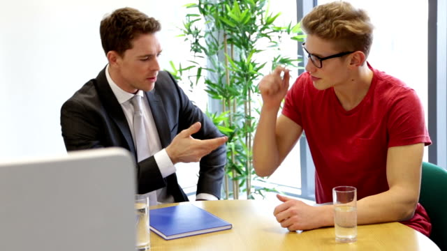 meeting between student and teacher - job interview stock videos and b-roll footage