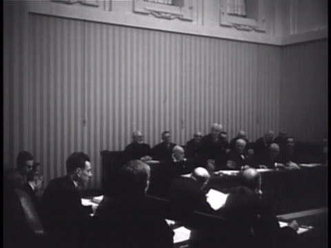 meeting room w/ male standing at table w/ others speaking to group of men fg ms agostino gemelli holding hand to ear - philosopher stock videos & royalty-free footage