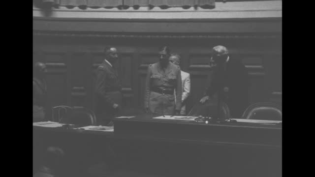 int meeting room with officials walking up steps to dais / charles de gaulle leader of the french committee of national liberation and henri giraud... - french national assembly stock-videos und b-roll-filmmaterial