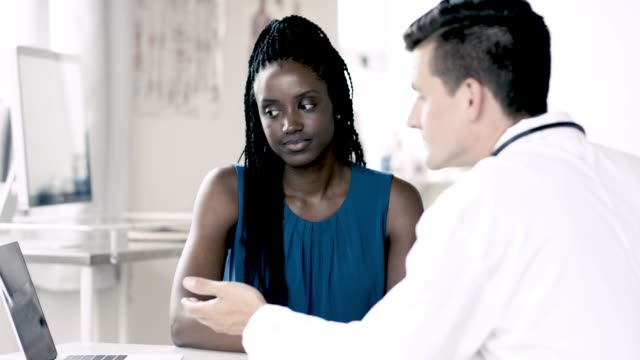 meeting the male doctor - general practitioner stock videos & royalty-free footage