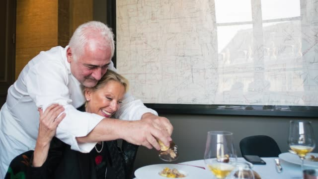 meeting with the chef guy savoy walking in the streets of paris in the kitchen of his restaurant la monnaie with his collaborators at home with his... - fiancé stock videos & royalty-free footage