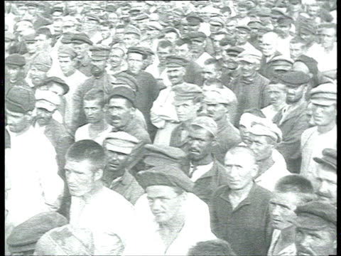 vídeos de stock, filmes e b-roll de meetings in belomor canal labor camp: prisoners gathered, crowd, brass band, cheka ogpu-nkvd agents / russia - 1933