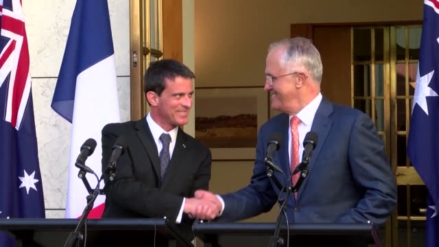 a mega deal to build australian submarines is so important french prime minister manuel valls says that he pledged to personally supervise the... - nackenrolle kopfkissen stock-videos und b-roll-filmmaterial