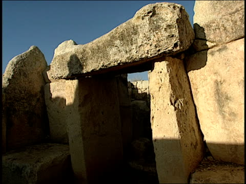 megaliths make up the doorway of a stone temple. - obelisk stock videos & royalty-free footage