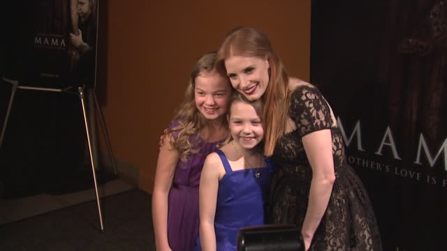megan charpentier, isabelle nélisse and jessica chastain at mama premiere at landmark sunshine cinema on january 08, 2013 in new york, new york - landmark sunshine theater stock videos & royalty-free footage