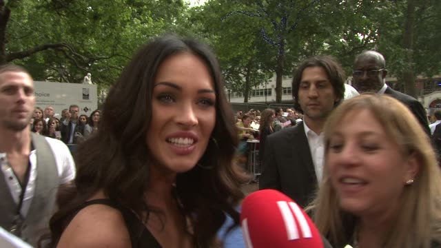 megan fox on her reaction to a sign which read 'megan fox makes me question my homosexuality' at the transformers revenge of the fallen uk premiere... - megan fox stock videos and b-roll footage