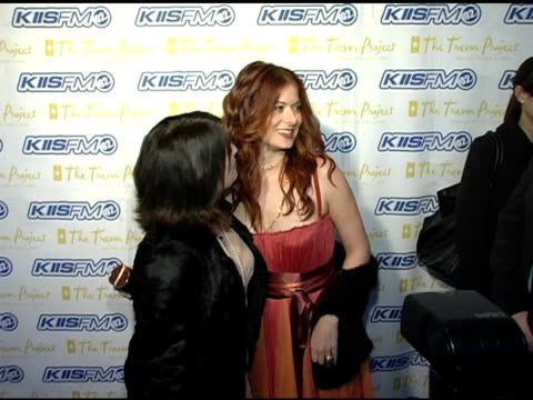 megan mullally and debra messing at the trevor project's 'cracked xmas 7' honoring debra messing and megan mullally at the wiltern theater in los... - debra messing stock-videos und b-roll-filmmaterial