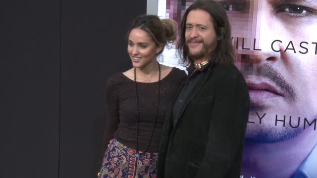 Megan Ozurovich and Clifton Collins Jr at the Transcendence Los Angeles Premiere at Regency Village Theatre on April 10 2014 in Westwood California