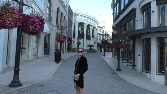 megan pormer poses for photos amid the coronavirus outbreak on empty rodeo drive in beverly hills in celebrity sightings in los angeles - beverly hills california stock videos & royalty-free footage