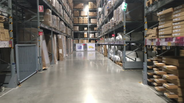 megastore/warehouse with packages - dolly shot stock videos & royalty-free footage