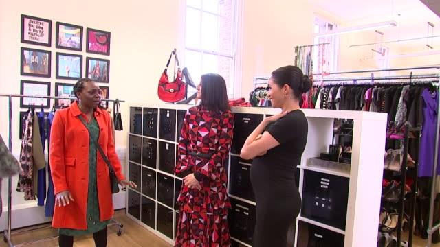 stockvideo's en b-roll-footage met meghan duchess of sussex helping women choose outfits at smart works in kensington one of her patronages - kleding