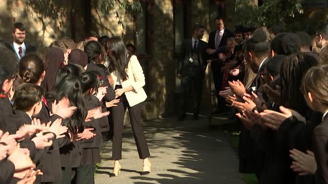 meghan duchess of sussex walks through line of cheering schoolchildren during visit to robert clack school of science in dagenham - multiracial group stock videos & royalty-free footage
