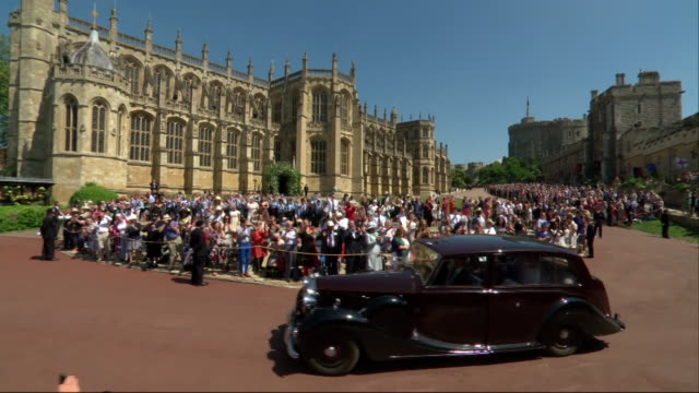 Meghan Markle arrives at St George's Chapel by car with pageboys for her wedding to Prince Harry