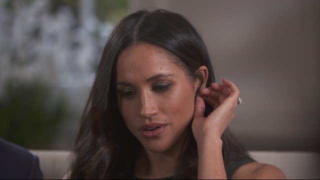 meghan markle explaining that growing up in the usa she didn't have the same understanding of the royal family - repetition stock videos and b-roll footage