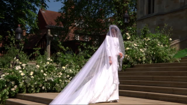 meghan markle gets out of her car and walks up the steps of st george's chapel before getting married to prince harry - building entrance stock videos & royalty-free footage