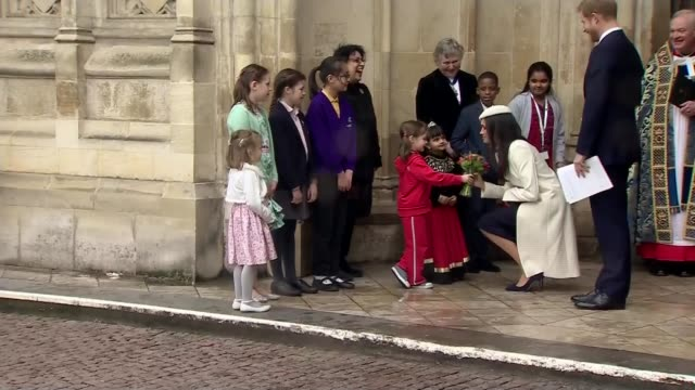 Meghan Markle makes first official appearance with the Queen EXT Children giving Meghan Markle bouquet of flowers