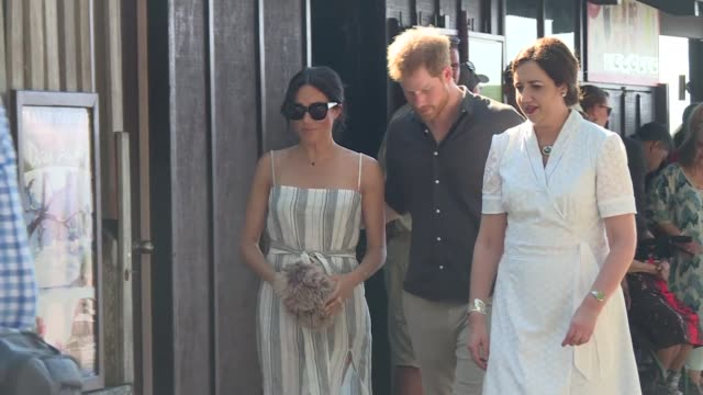 Meghan the pregnant wife of Britain's Prince Harry emerged from her break from official duties to greet excited fans on the World Heritage listed...