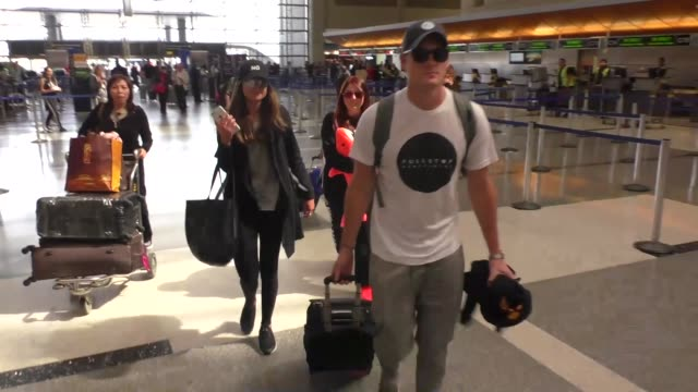 meghan trainor and new boyfriend daryl sabara holding hands while departing at lax airport in los angeles - meghan trainor stock videos & royalty-free footage