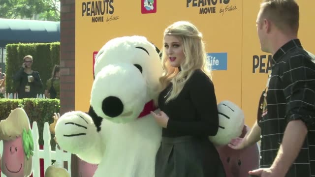 Meghan Trainor and the cast and director appear on the red carpet for the premier of The Peanuts Movie
