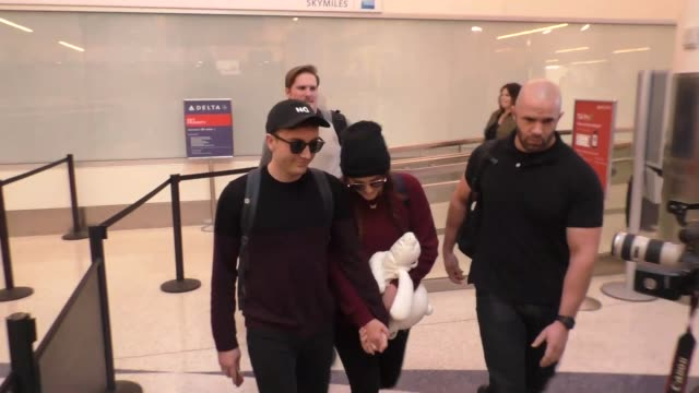 meghan trainor daryl sabara holding hands as they depart at lax airport in los angeles in celebrity sightings in los angeles - meghan trainor stock videos & royalty-free footage