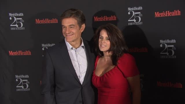 mehmet oz and lisa oz at men's health celebrates 25th anniversary at isola, mondrian soho hotel on october 09, 2013 in new york, new york - メフメト オズ点の映像素材/bロール